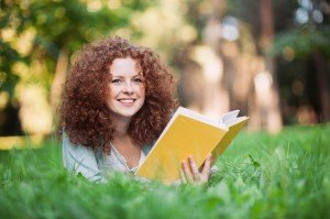 Beautiful girl holding an open book